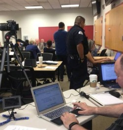 "A PIO360 crisis communications media training, featuring a web-based collaboration space for three ""teams"" to concurrently work the same scenario, and then test skills via mock news conferences and big screen readouts of press updates and social media messages."